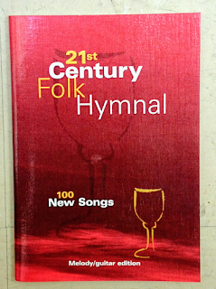 Cover of the 21st century folk hymnal - red glossy hymn book