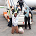 Nigerian man deported from Libya goes on his knees on the tarmac to thank God