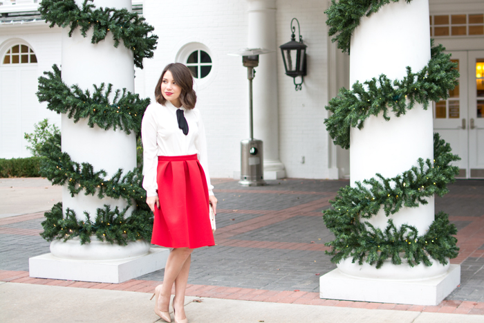 christmas eve outfit idea, holiday party look, outfit ideas, red midi skirt, midi skirt, pussybow blouse, nude heels, midi skirt, fashion blogger christmas, red lipstick, nars cruella