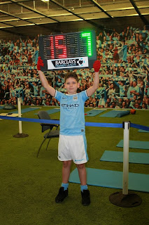 Young fan holding the score board at Manchester City
