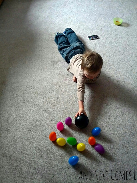 J bowling with wobbly Easter eggs from And Next Comes L