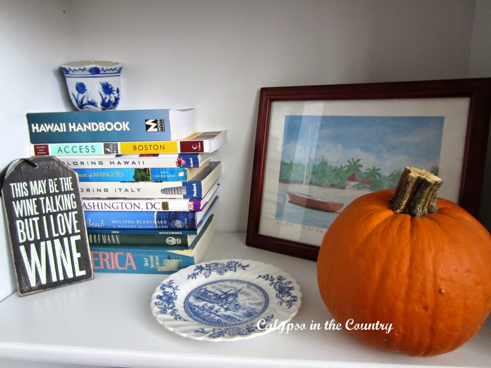 Shelf styling with blue and orange for fall