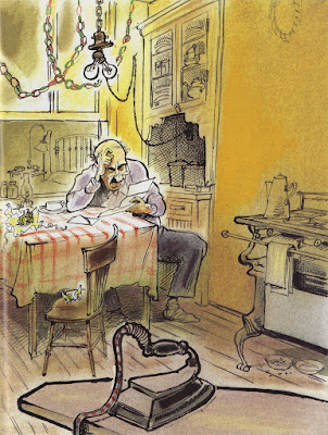 Older man reads a poem while sitting at a table