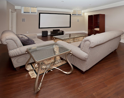 Luxury vinyl makes this basement movie room easy to maintain and beautiful.