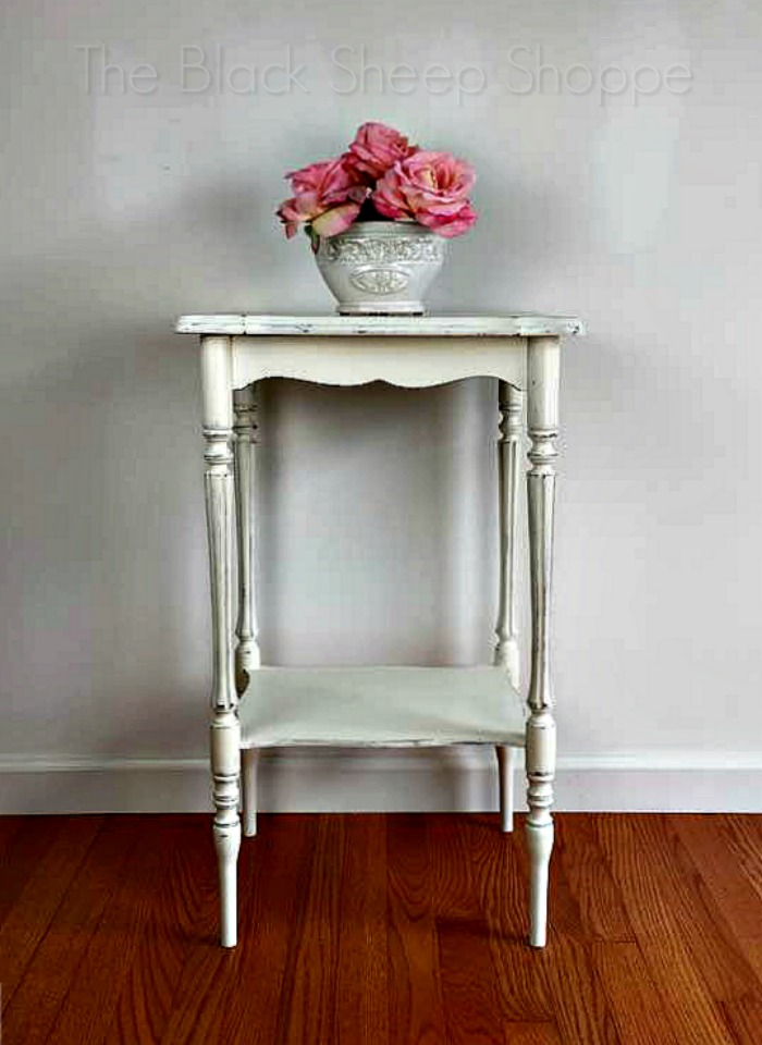 Side table with a shabby chic finish.