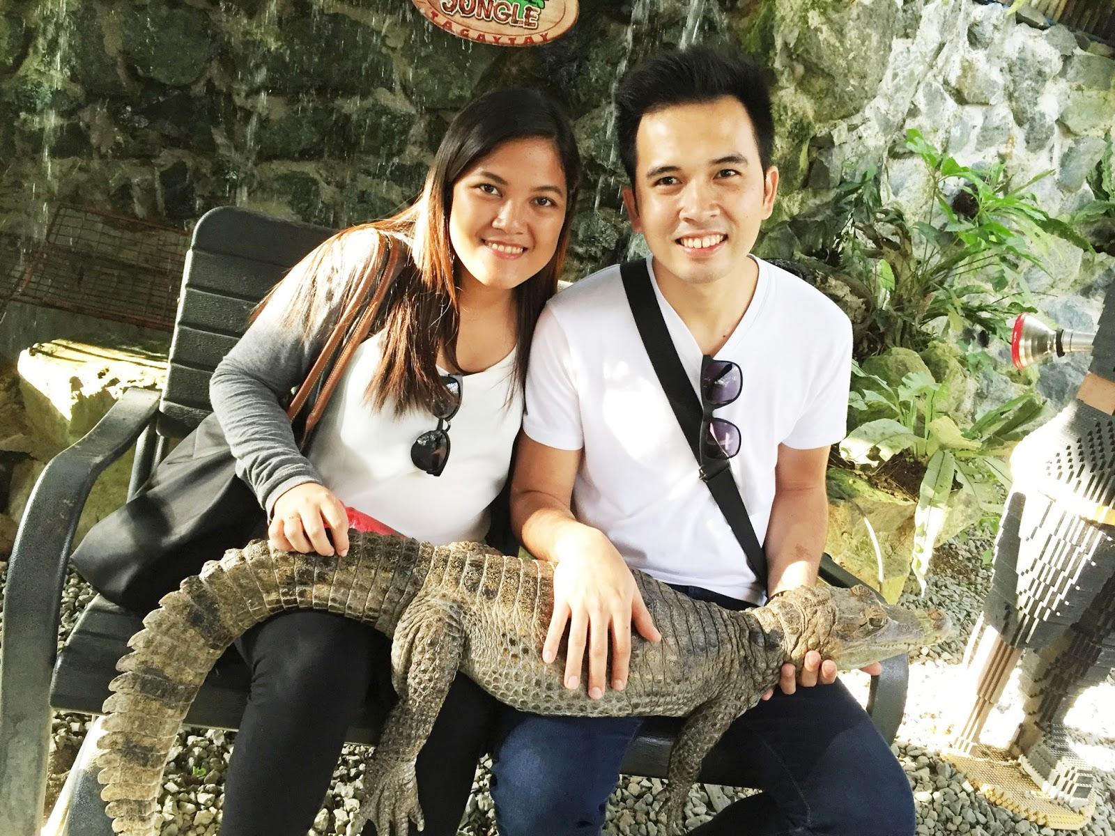holding a crocodile