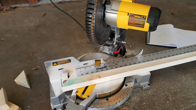 miter saw cutting 40 degree miters with yardstick to mark next cut