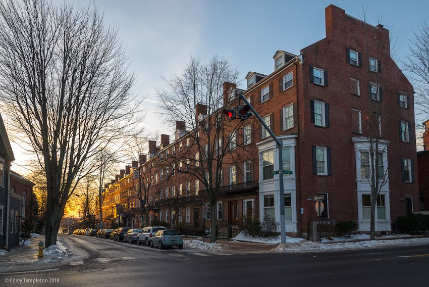 Portland, Maine USA January 2018 photo by Corey Templeton. The sun beginning to rise beyond the stately row house on Park Street.