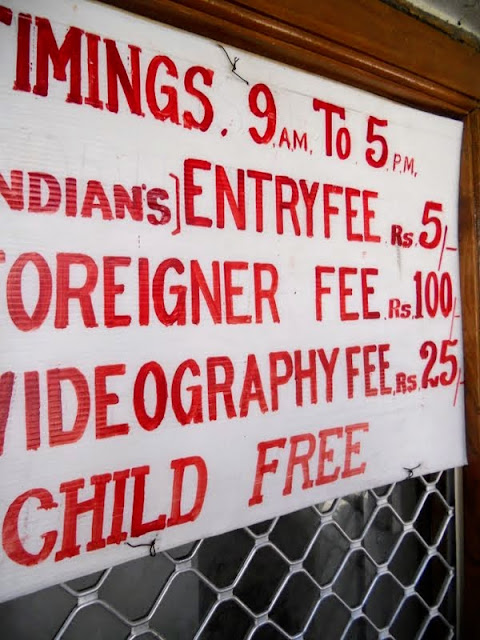 Sign with disparate prices for locals and foreigners in Hyderabad India