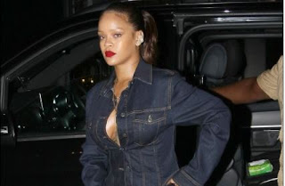 Rihanna shows off Cleavage in Denim shirt as she parties in London