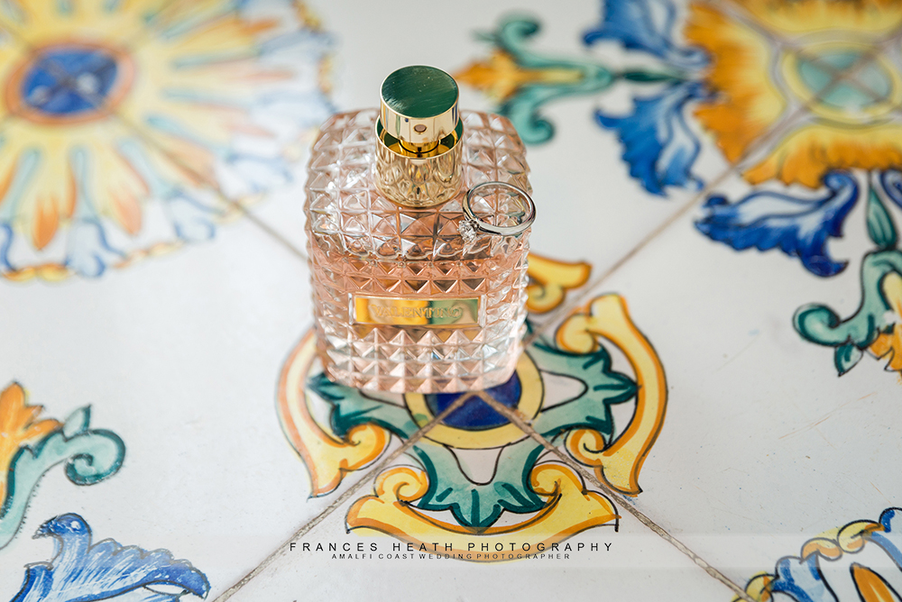 Bride details hand painted ceramic tiles perfume and wedding ring