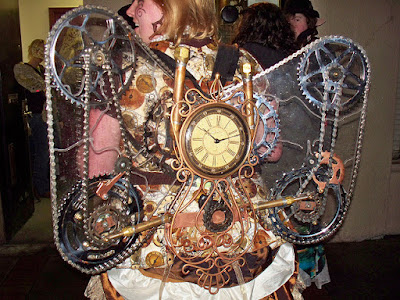 steampunk wings for cosplay and halloween costumes. Gears, chains, pulleys and a working clock with steam guages make these steampunk wings unique