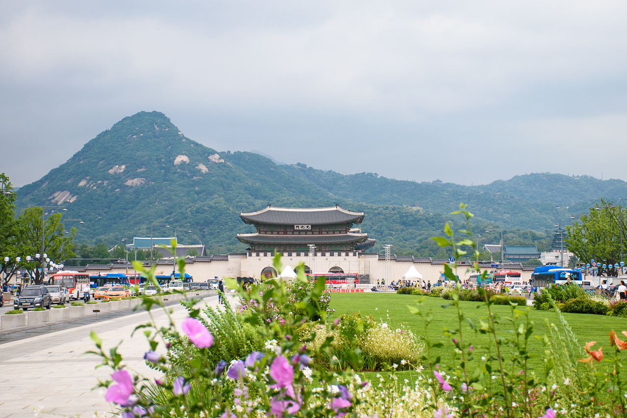 gyeongbokgung palace in seoul against a beautiful scenery, mountains and modern architecture
