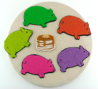 five felt pigs and felt pancakes
