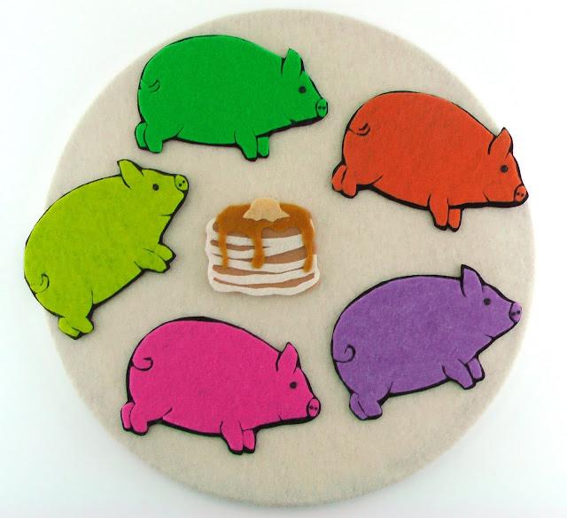 five felt pigs and felt pancakes