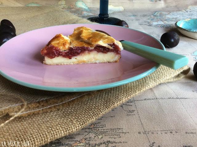 porción-de-pastel-vasco-relleno-de-crema-pastelera-y-cerezas