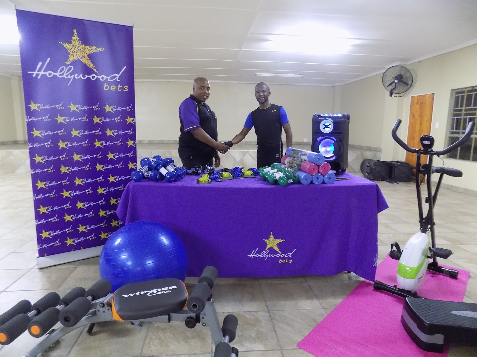 Muzi Gumede from Bhekithemba Drug and Substance Abuse Organisation receives new gym equipment from Hollywoodbets Empangeni