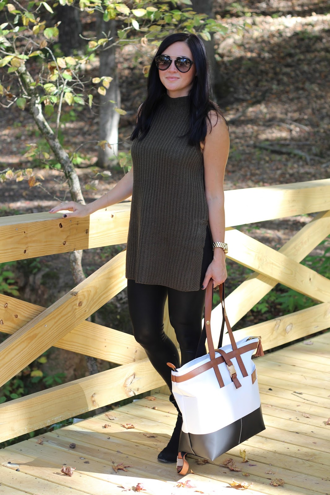 Sleeveless sweater tunic, leather leggings