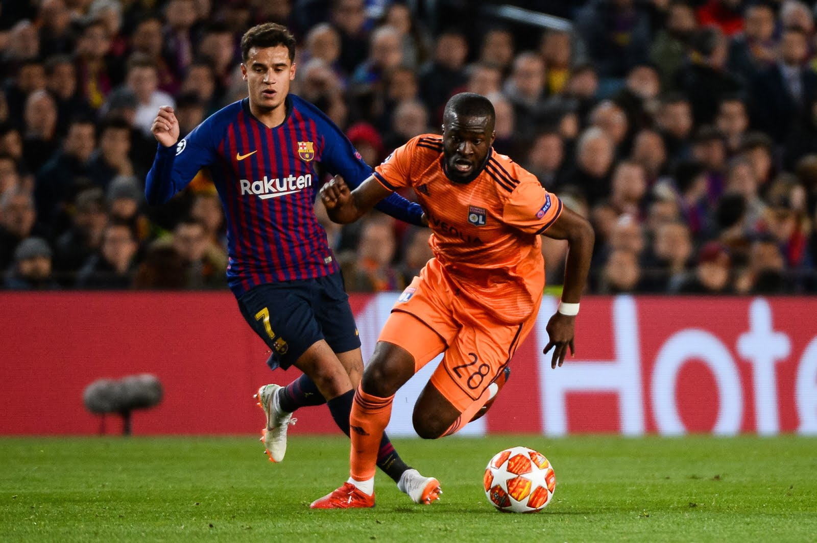 Philippe Coutinho of Barcelona and Tanguy Ndombele of Lyon during the UEFA Champions League Round of 16 Second Leg match between Barcelona and Lyon at Camp Nou on March 13, 2019 in Barcelona, Spain