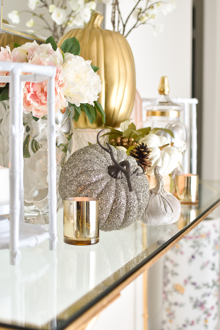 Glitter, gold, sequin and velvet pumpkins paired with peony florals, metallic decor and chinoiserie candles for a fall console table decoration. | #falldecor #falldecorating #interiordesign #monicawantsit