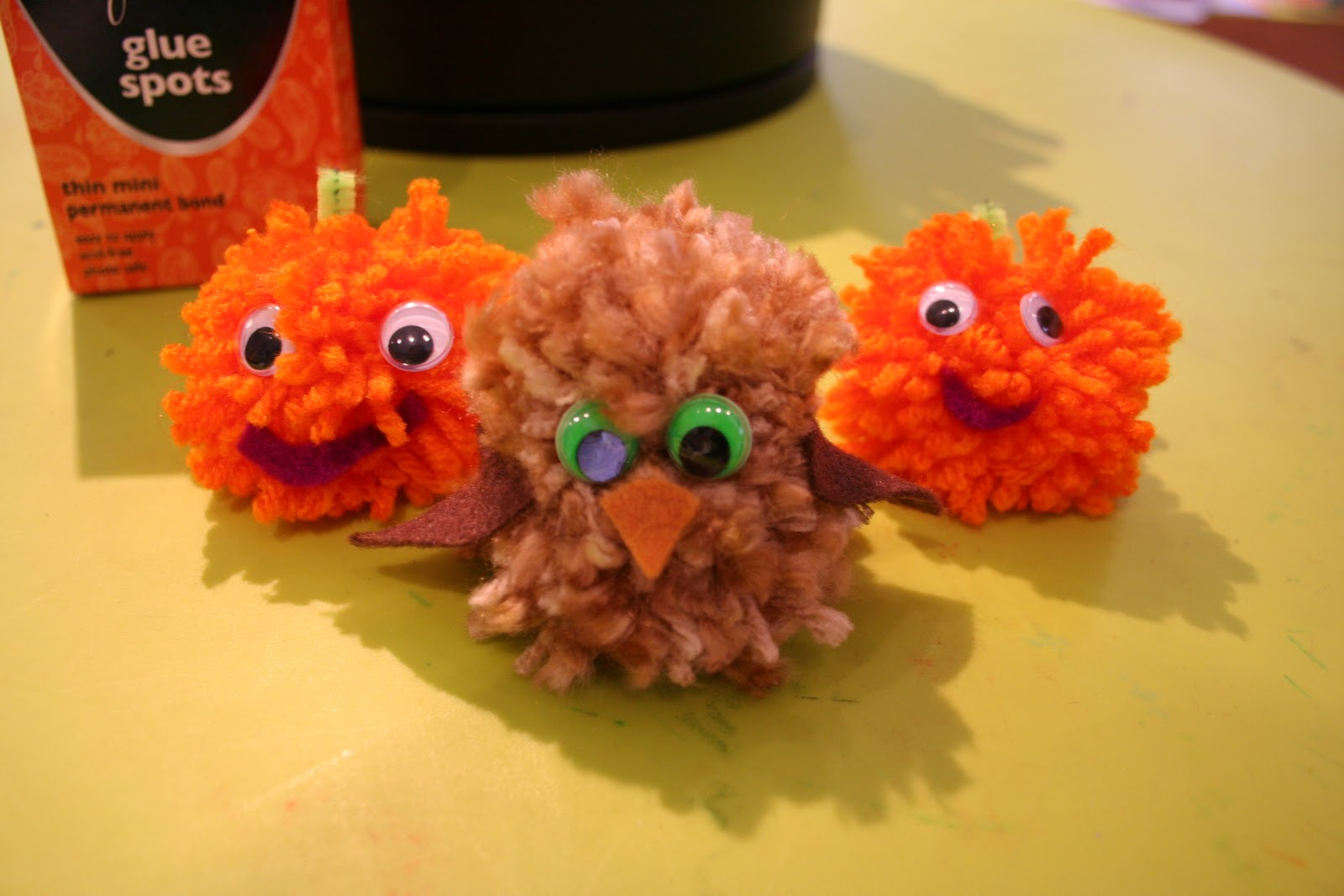 halloween crafts for kids yarn pom pom pumpkins owls and monsters oh my - Halloween Pom Poms