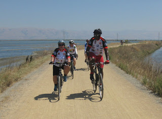 Cyclists heading north on the Bay Trail, Sunnyvale, California