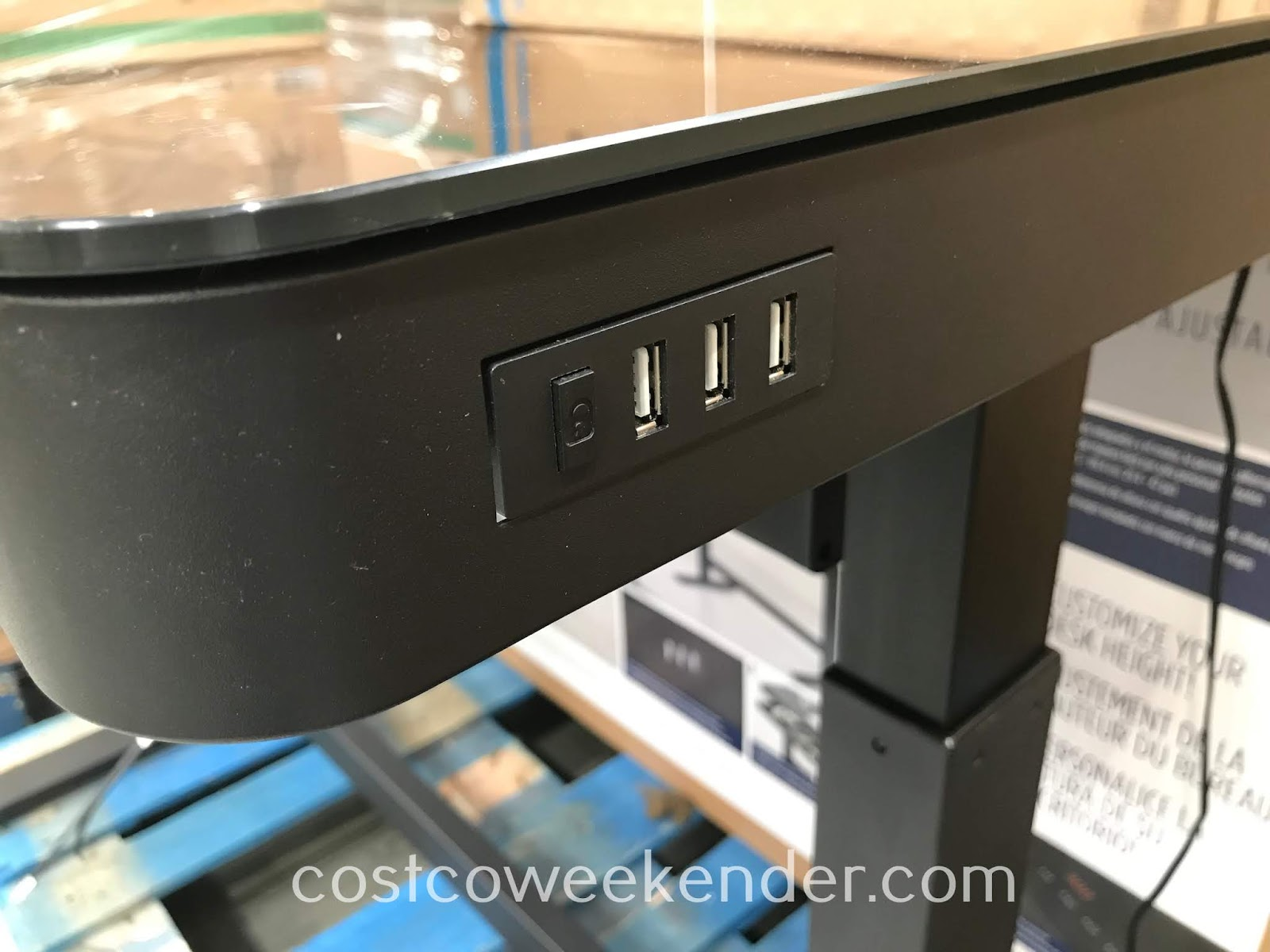 The Tresanti Adjustable Height Desk features convenient USB ports for your devices