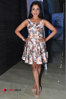Actress Madhu Shalini Stills in Floral Short Dress at RGV Shiva to Vangaveeti Event  0194.JPG