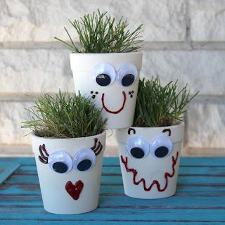 http://www.doodlecraftblog.com/2016/05/grass-head-planters.html