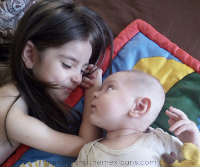 Life With Baby At 4 Months Old - Image Shows Big Sister And Baby Looking At Each Other