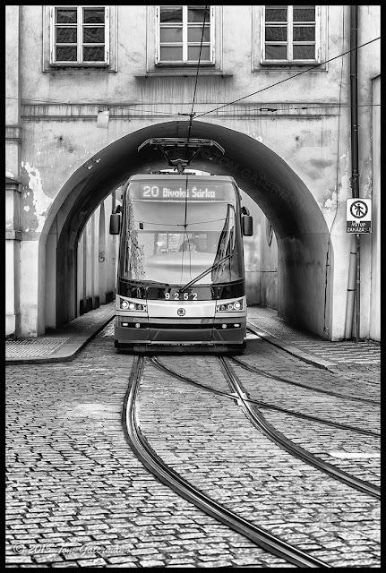 Tram 9252 under an archway on Letenská street in Lesser Town Prague