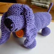 http://www.ravelry.com/patterns/library/dachshund-sausage-dog
