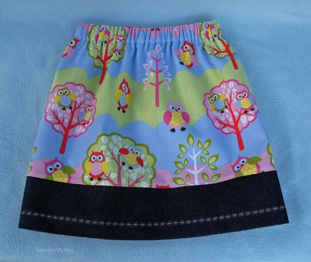 Learn how to make a gathered skirt with an embroidered denim band. Tutorial by Threading My Way
