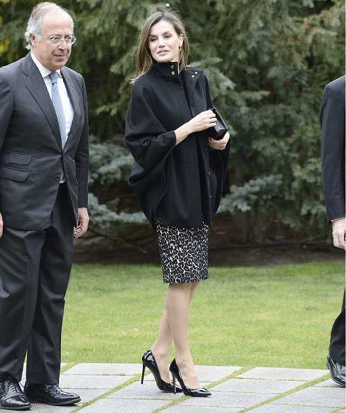 Queen Letizia wore Roberto Verino Jacquard pencil skirt and Hugo Boss Capina wool cape. Queen Letizia carried Nina Ricci Arc Clutch