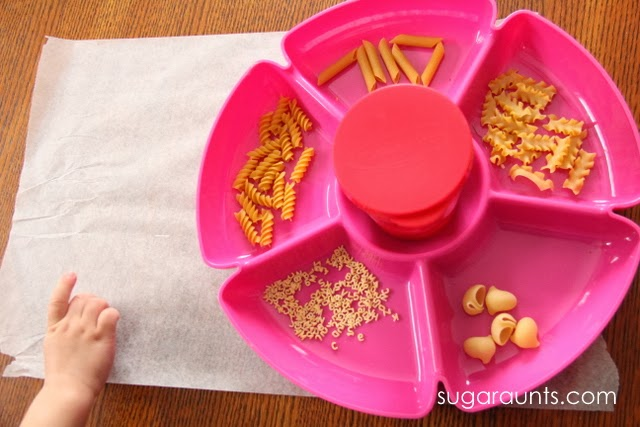 Painting a variety of noodle types is a great fine motor and sensory experience for Toddlers.