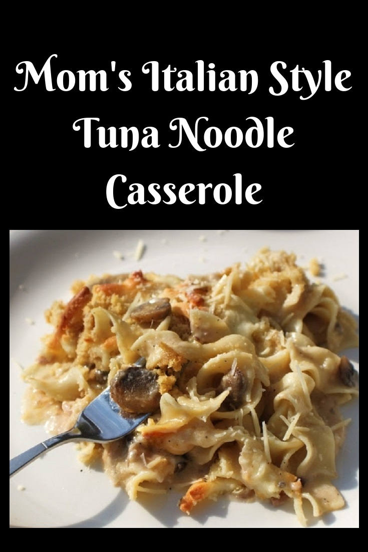 Mom's Italian Style Tuna Noodle Casserole dish is with tuna and the casserole is made with a cheese sauce then baked in a white oven proof deep casserole dish and delicious sauce over noodles