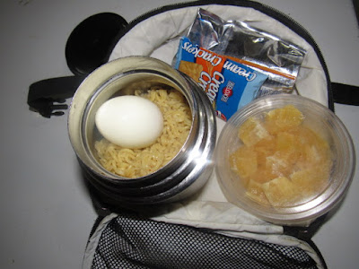 Nigerian school lunchbox meal of noodles with boiled egg