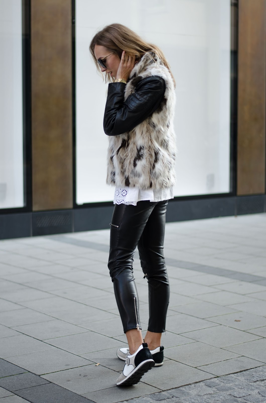 kristjaana mere zara faux fur vest leather pants sneakers black white causal fall outfit