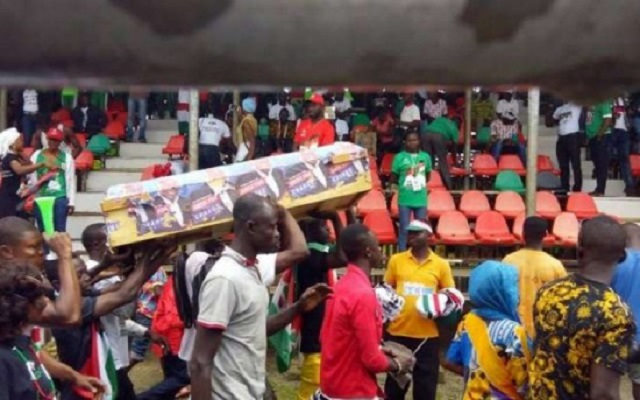 Young men paraded a mock coffin of the NPP's flagbearer in Sunyani