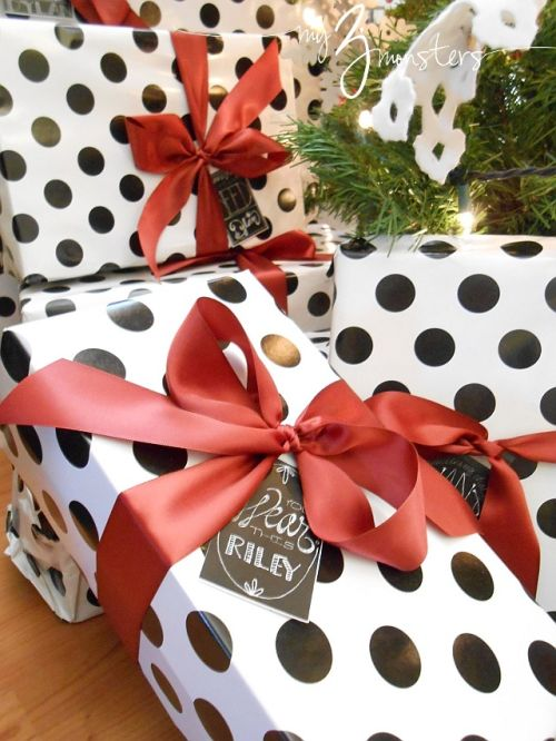 Christmas gift wrapping - elegant black and white with red ribbon