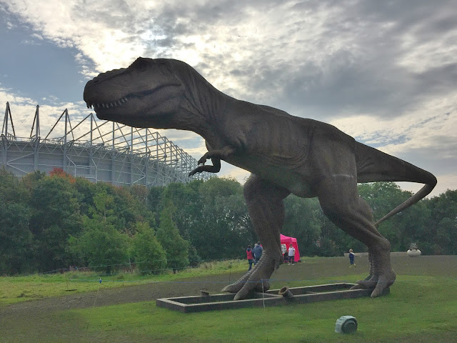 Giant T-rex overlooking st james park newcastle