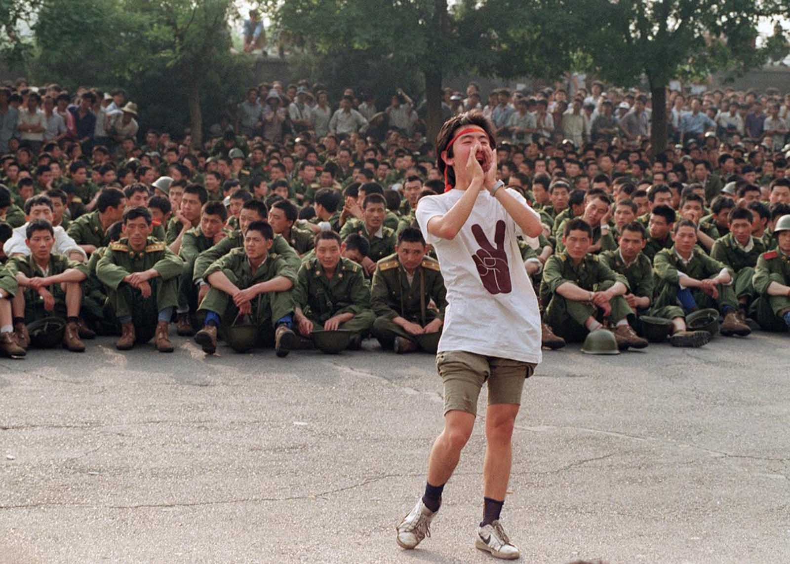A dissident student asks soldiers to go back home as crowds flooded into the central Beijing, on June 3, 1989.
