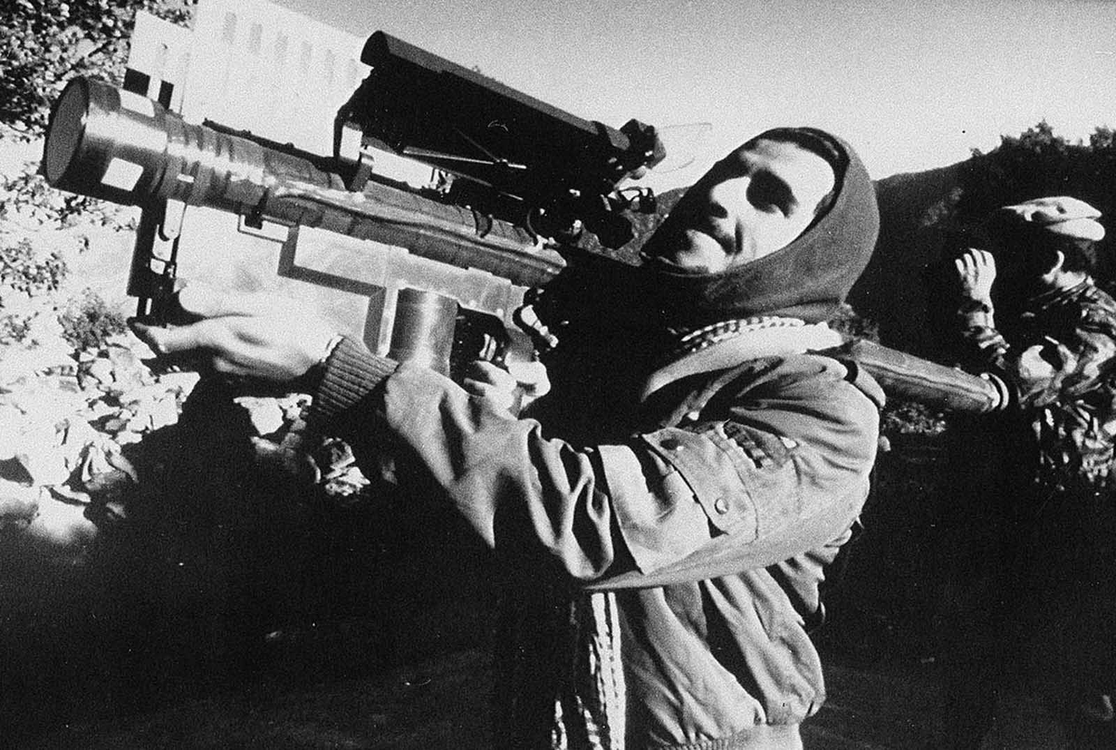 An Afghan guerrilla handles a U.S.-made Stinger anti-aircraft missile in this photo made between November 1987 and January 1988. The shoulder-fired, heat-seeking missile supplied to the Afghan resistance by the CIA during the Soviet invasion of Afghanistan, is capable of bringing down low-flying planes and helicopters. At one point, late in the war, rebels were reportedly downing nearly one Soviet aircraft every day with Stinger missiles.