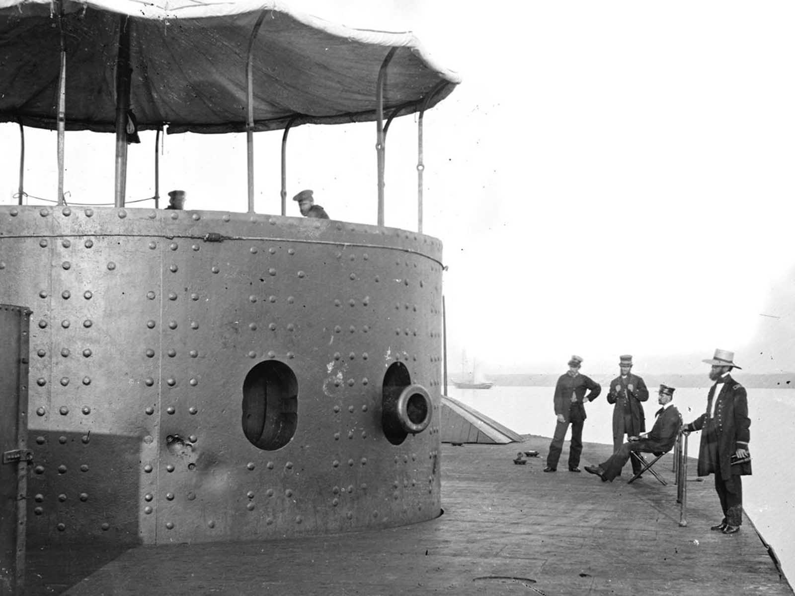 The deck and turret of the ironclad U.S.S. Monitor on the James River, Virginia, on July 9, 1862. the Monitor was the first ironclad warship commissioned by the U.S. Navy, and famously fought the Confederate ironclad CSS Virginia (built from the remnants of the USS Merrimack) in the Battle of Hampton Roads -- the first meeting in combat of ironclad warships -- on March 8-9, 1862.