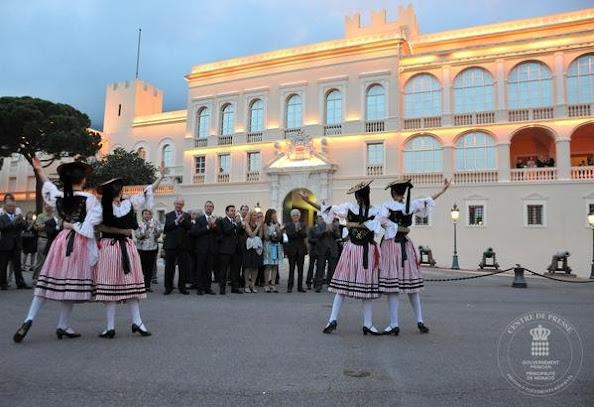 Princess Caroline of Hanover and Prince Albert II of Monaco attend the 'Fete de la St Jean' procession