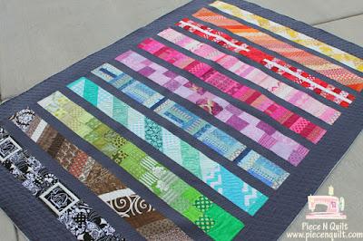 http://www.pieceandquilt.com/2011/10/modern-row-quilt.html