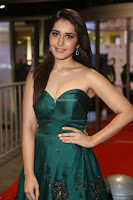 Raashi Khanna in Dark Green Sleeveless Strapless Deep neck Gown at 64th Jio Filmfare Awards South ~  Exclusive 132.JPG