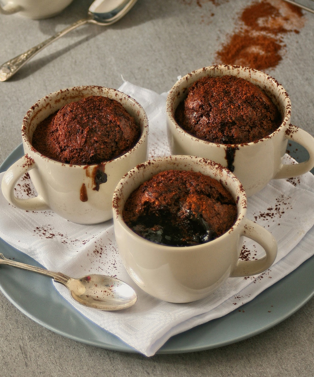 Baked saucy chocolate and coconut puddings.