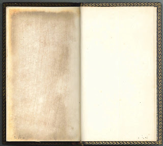 An open book. Both visible pages are blank.