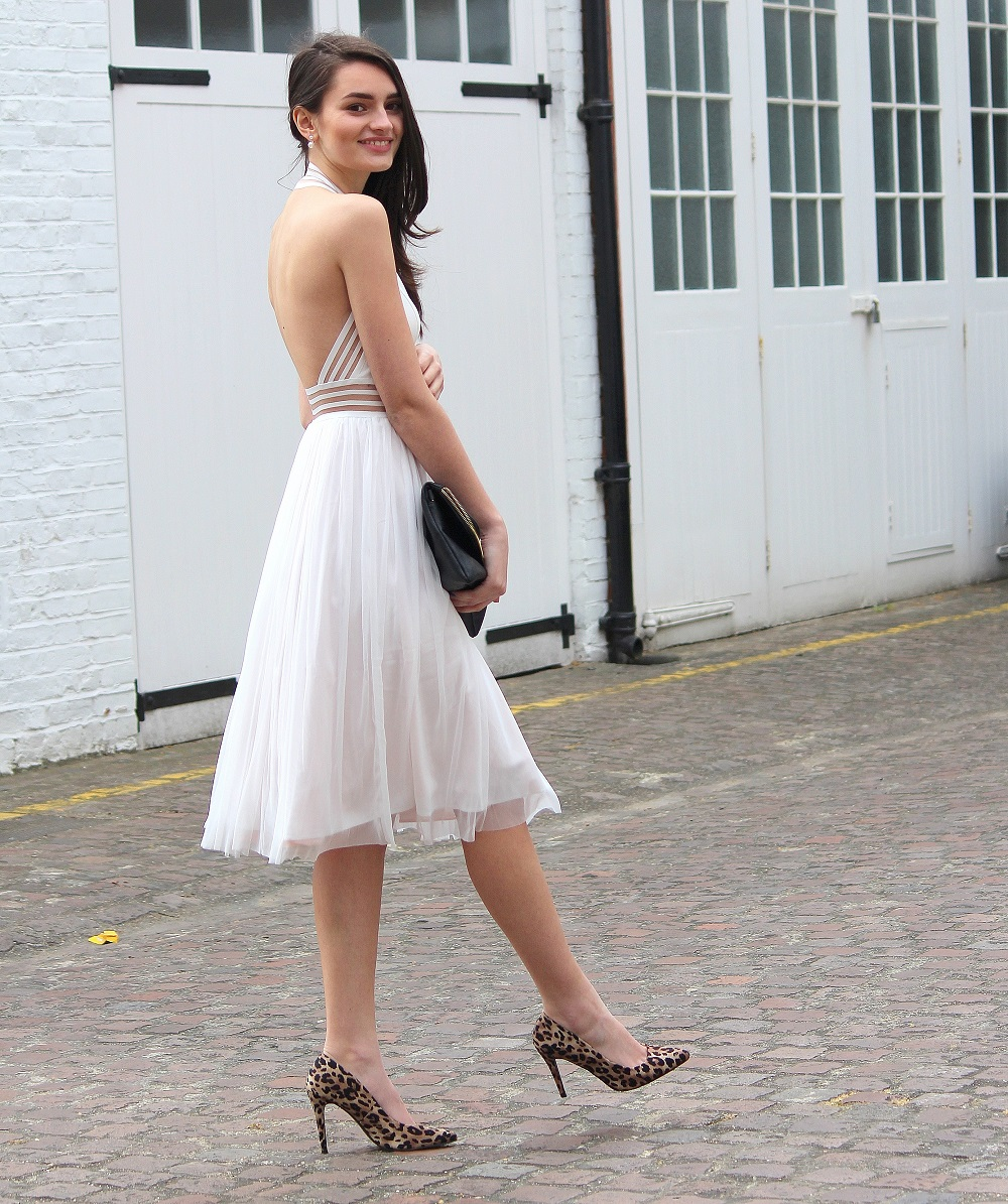 peexo fashion blogger wearing white backless dress and leopard print heels and black clutch in spring